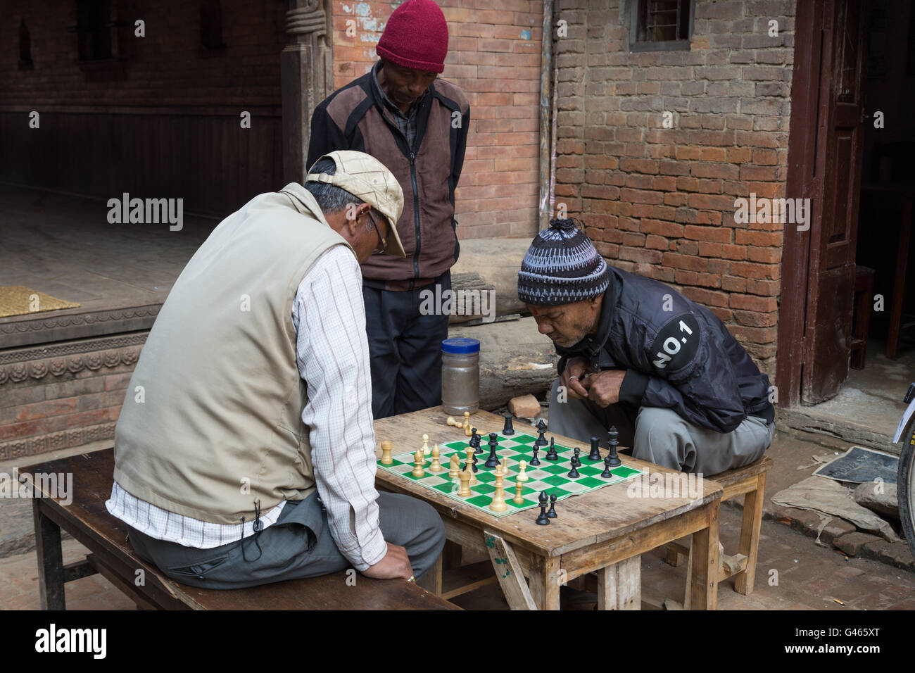 Bhaktapur, Nepal - December 5, 2014: Elderly men playing chess in the streets. - Stock Image