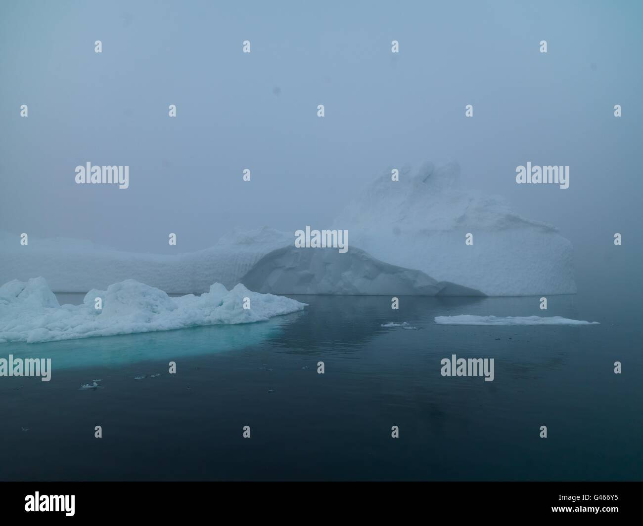 Huge icebergs are on the arctic ocean at Ilulissat ice fiord, Greenland - Stock Image