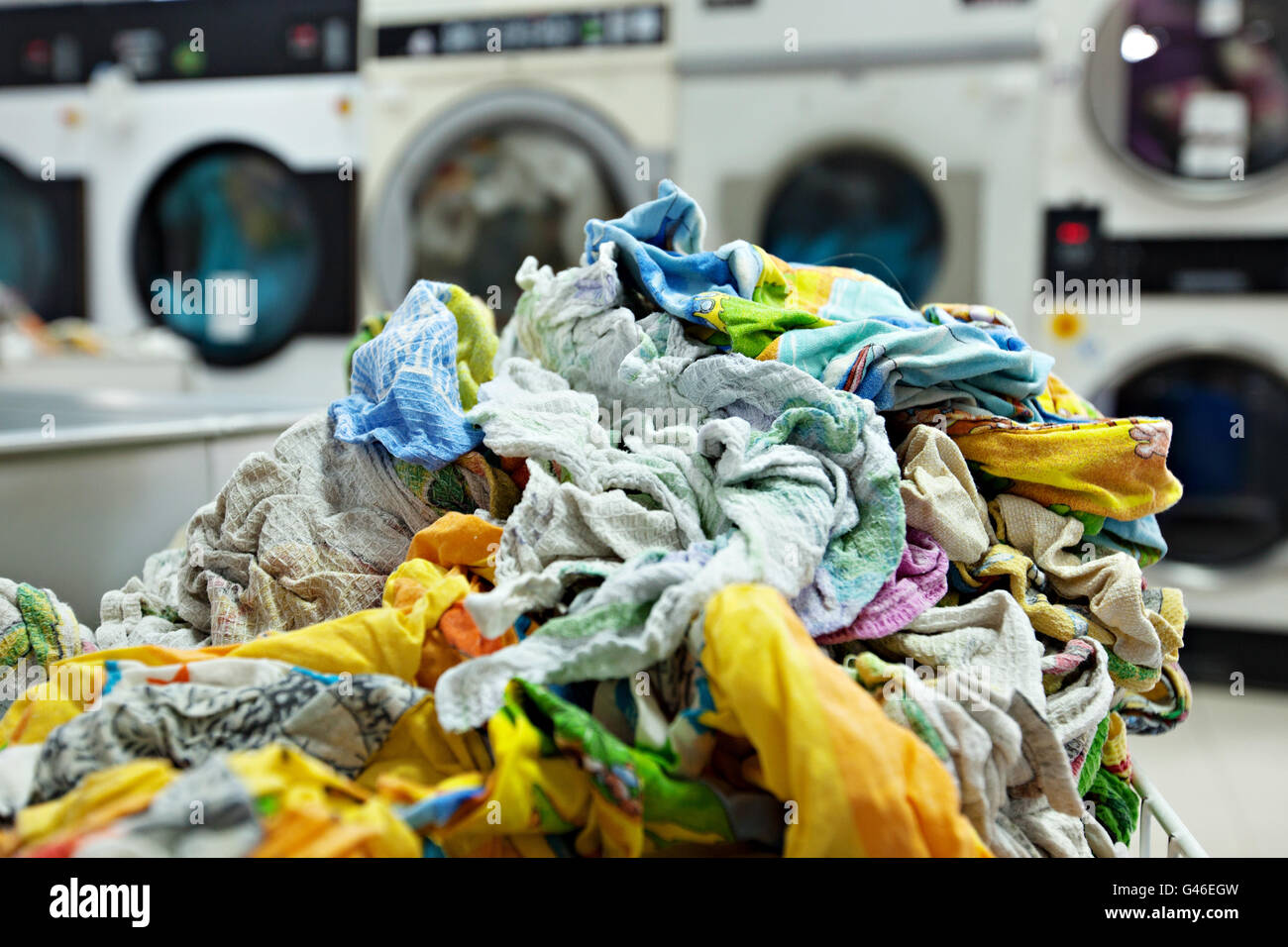 Pile of dirty laundry in laundrette - Stock Image