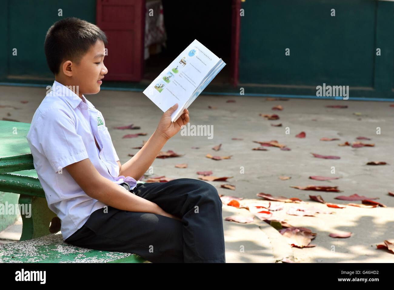 Schoolboy with book Vientiane Laos - Stock Image