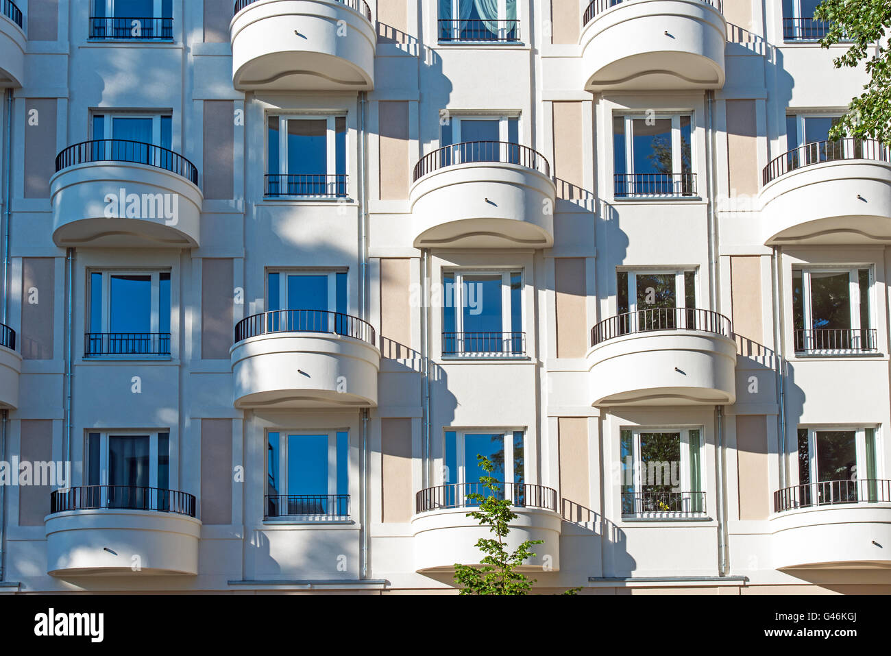 Facade of a modern apartment building with round balconies - Stock Image