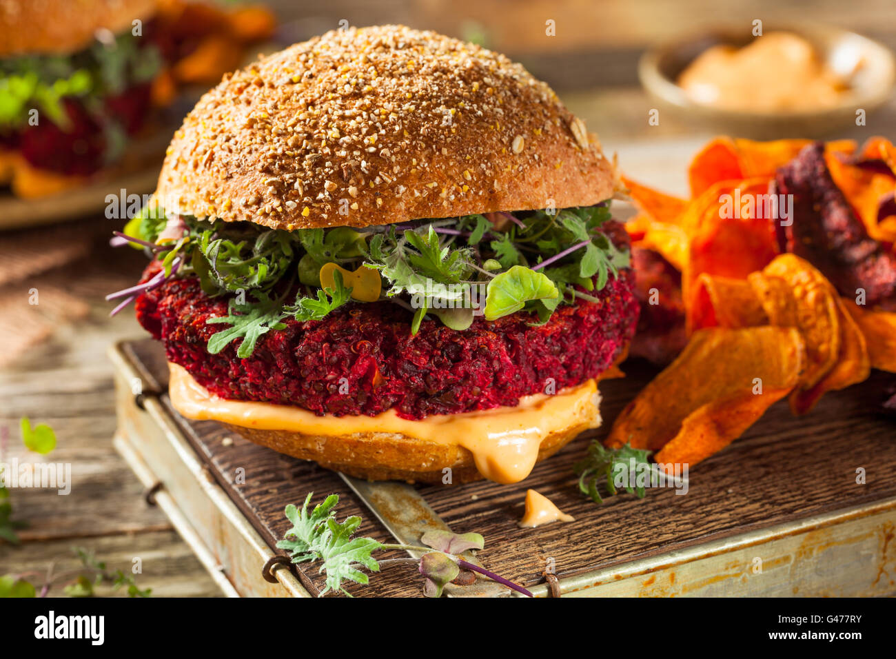 Healthy Baked Red Vegan Beet Burger with Microgreens - Stock Image