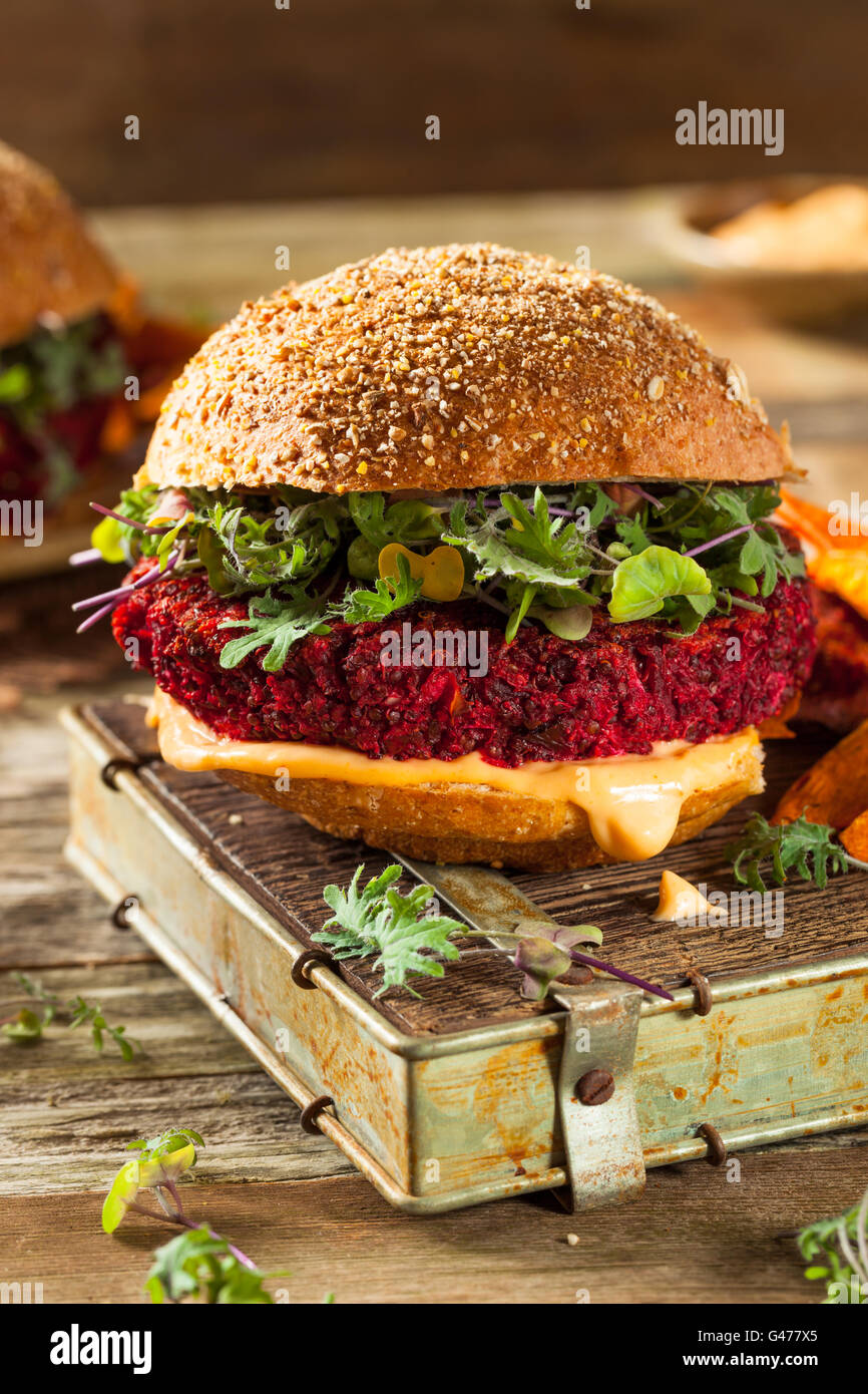 Healthy Baked Red Vegan Beet Burger with Microgreens Stock Photo