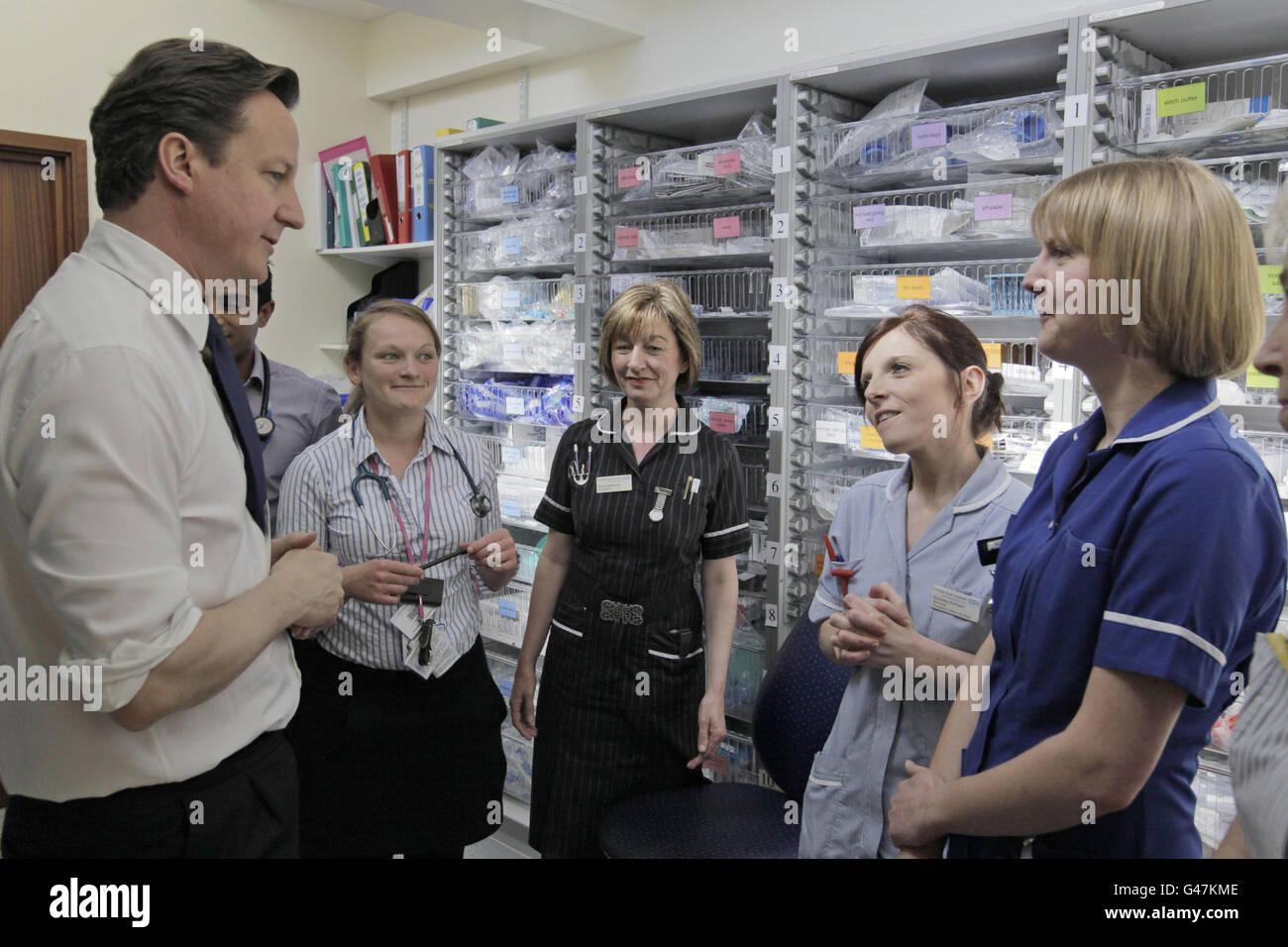 Britain's Prime Minister David Cameron talks to hospital staff at Frimley Park Hospital. Stock Photo