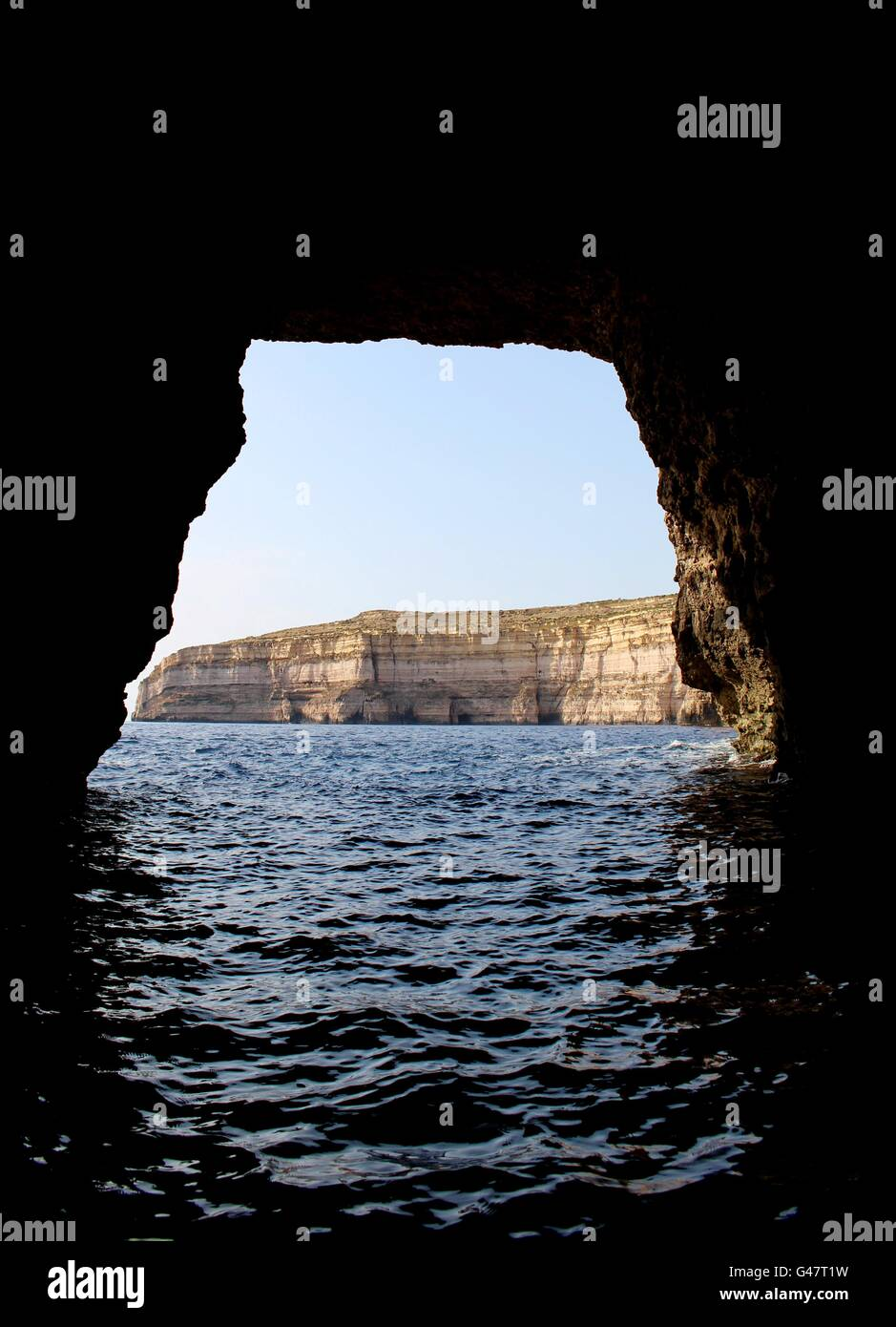 The journey through Gozo's limestone cliffs from the inland sea to the Mediterranean sea. - Stock Image