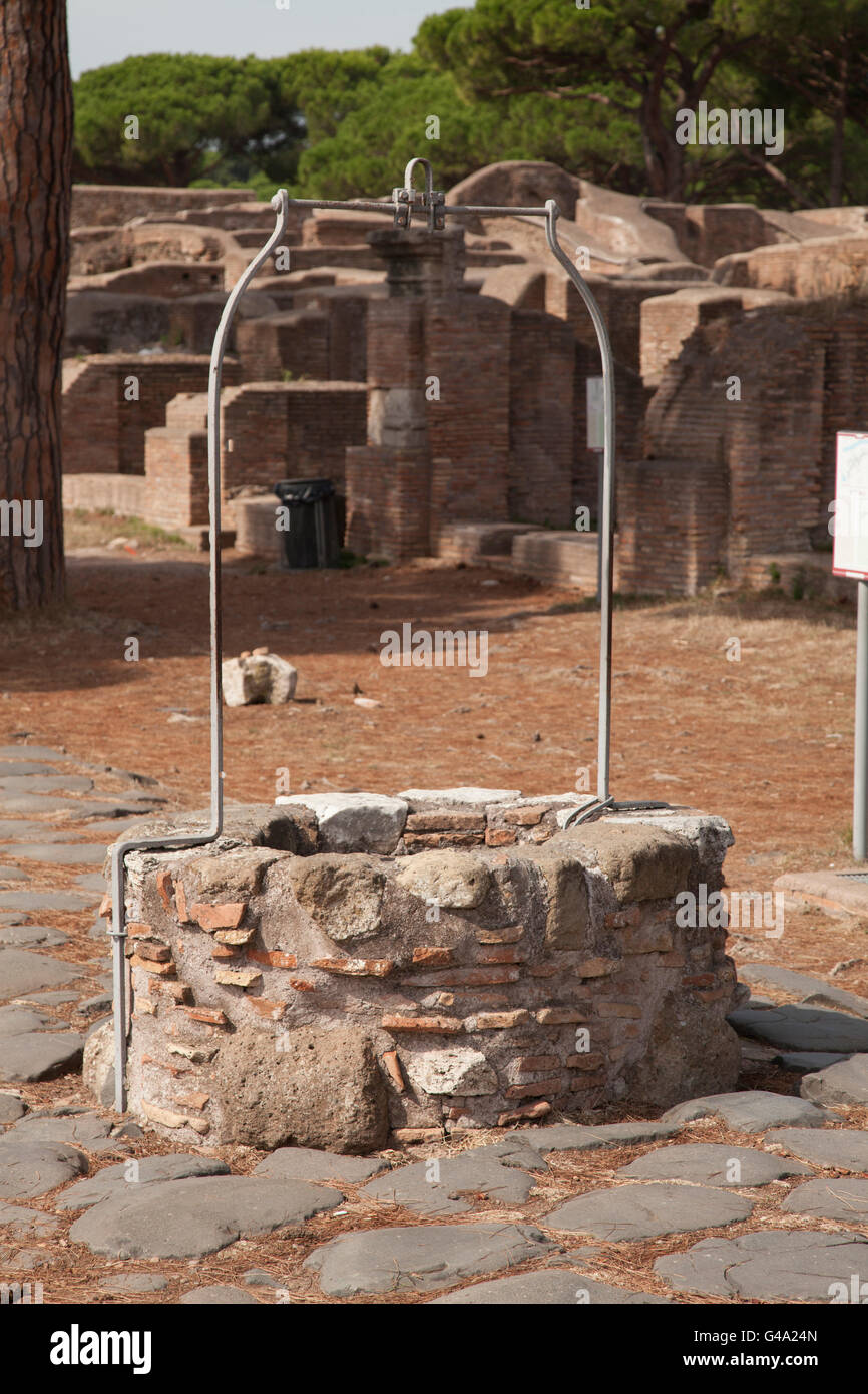 Well on the Decumanus at the ruins of the ancient port town of Ostia, Italy, Europe - Stock Image