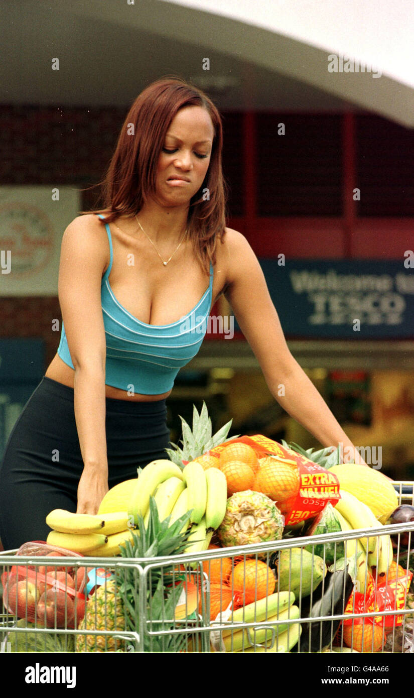 Cover girl model Tyra Banks with a trolley of fresh and
