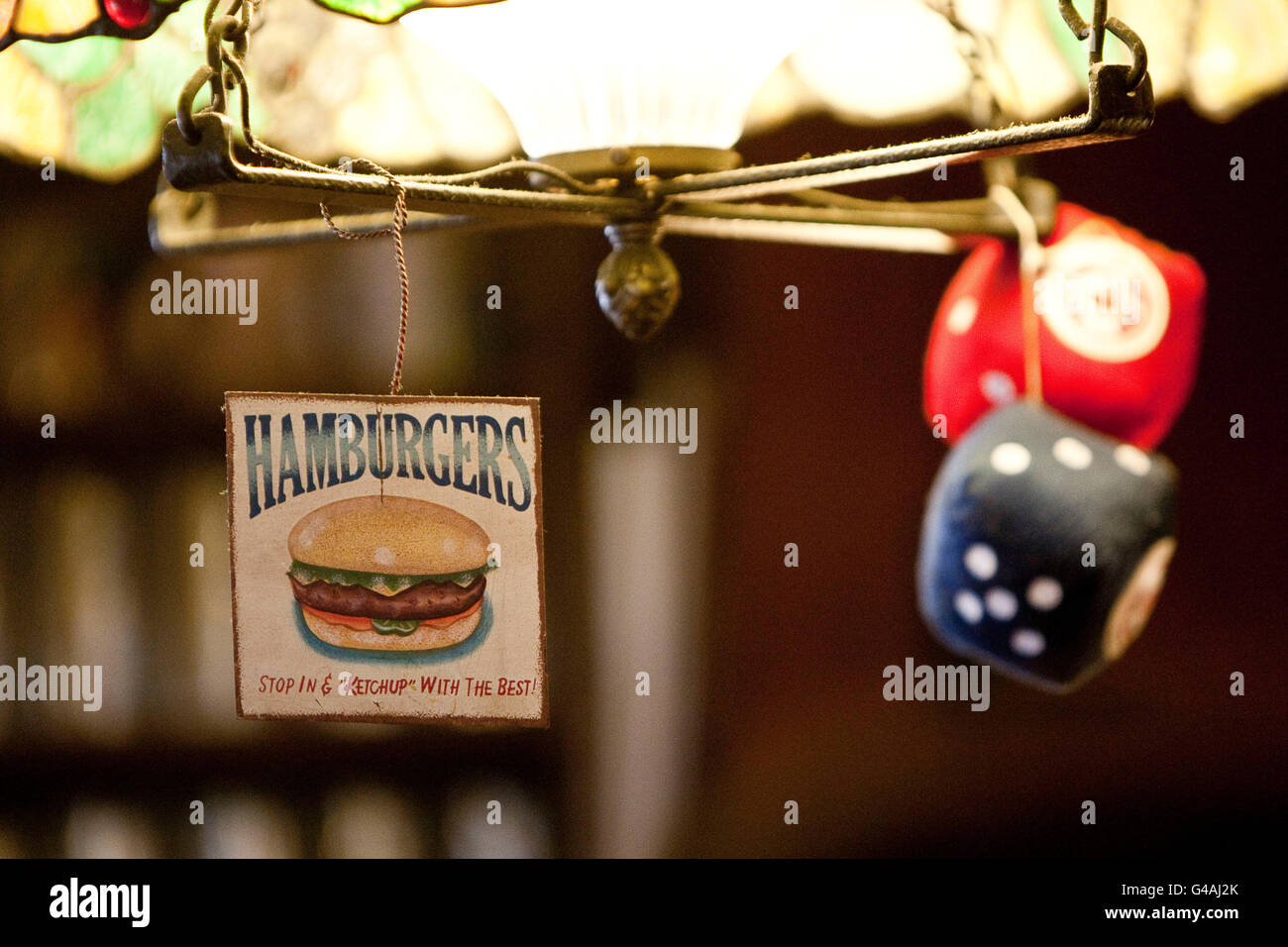 A 'stop in and ketchup with the best' hamburger sign hangs of a light at Louis' Lunch in New Haven, - Stock Image