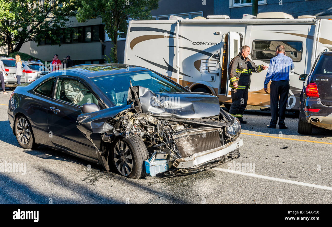 Emergency response fireman attends multi vehicle, head on collision, Vancouver, British Columbia, Canada, - Stock Image