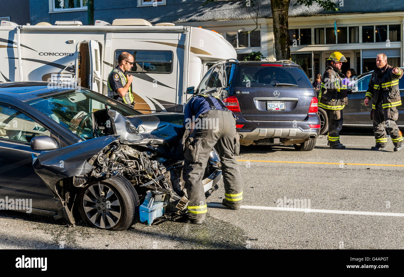 Emergency response firemen attend multi vehicle, head on collision, Vancouver, British Columbia, Canada, - Stock Image