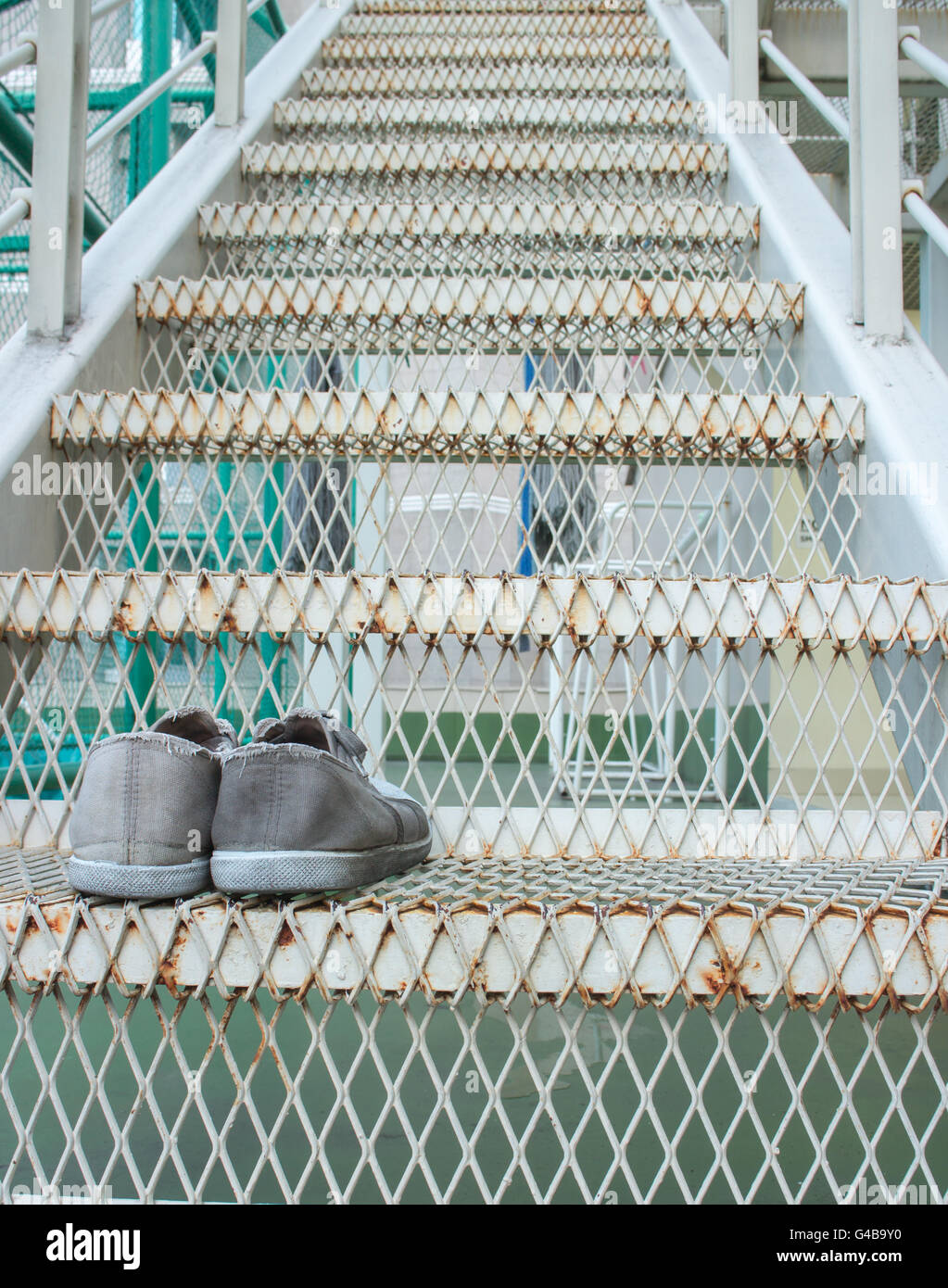sneakers  on the stairs. Making first step. - Stock Image