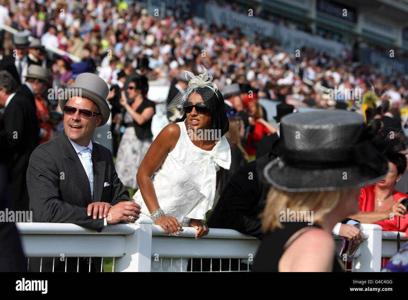 Race goers at the Investec Derby Day at Epsom racecourse in Surrey . - Stock Image
