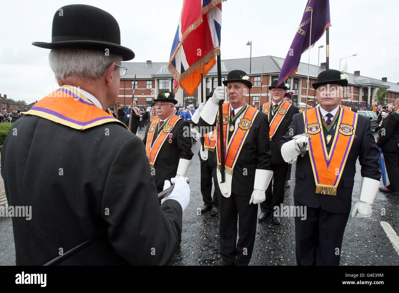 Orangemen gather at Carlisle Circus in Belfast as Orangemen celebrate the Twelfth of July which commemorates the 1690 Battle of the Boyne victory of a Protestant over a Catholic monarch. Stock Photo