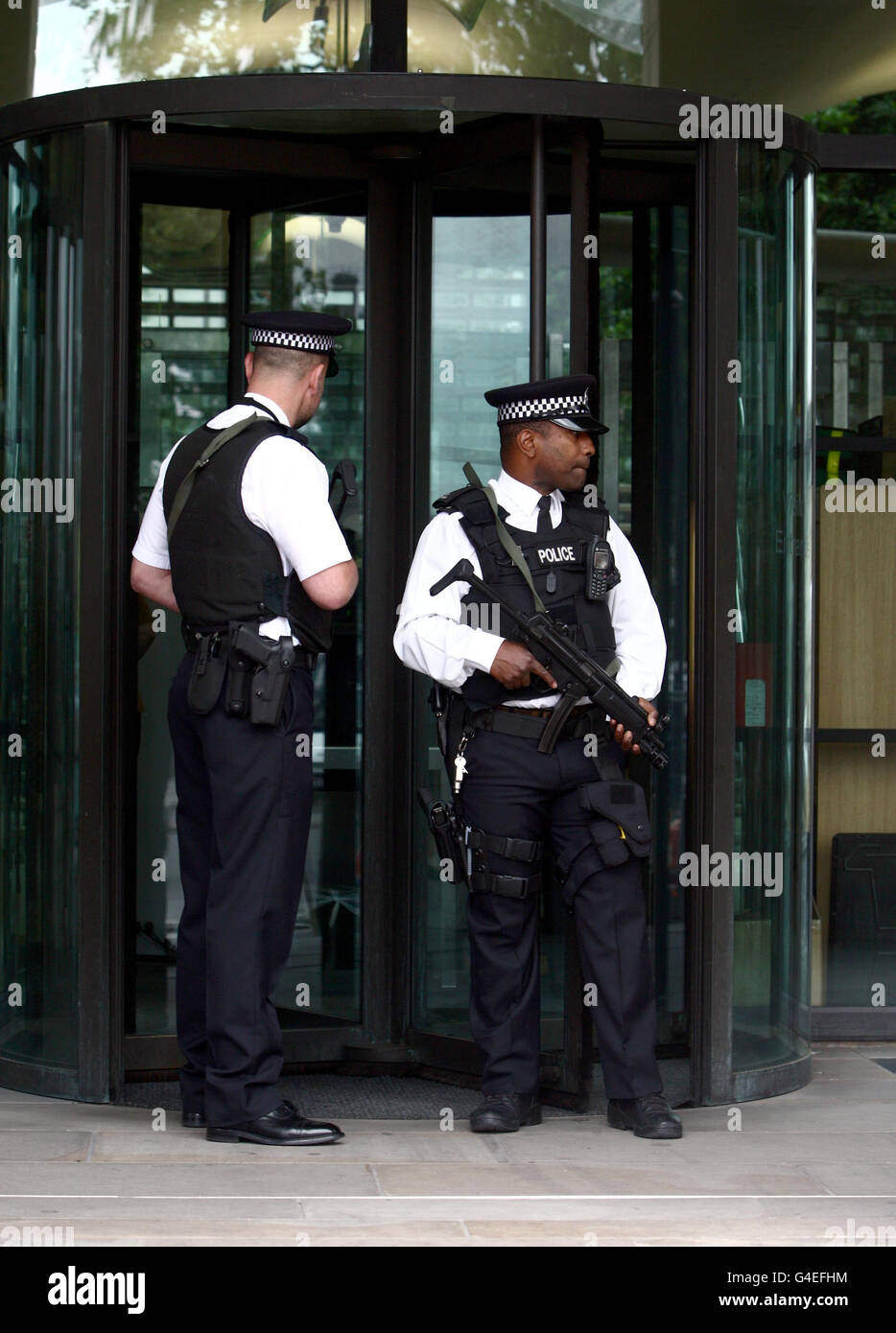 Police Outside Portcullis House In Westminster Stock Photos & Police