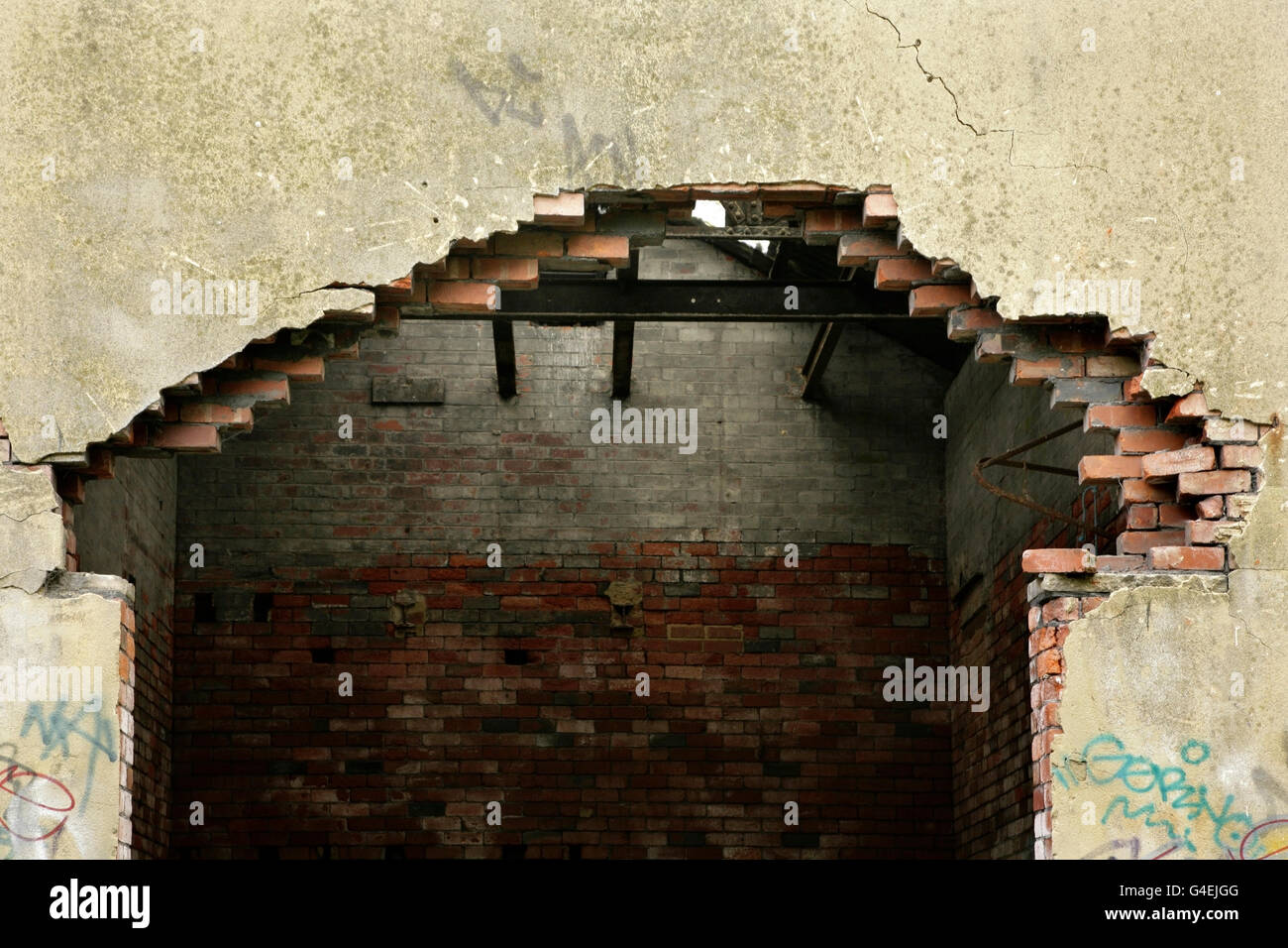 Brick wall collapsing after removal of steel supporting beam. - Stock Image