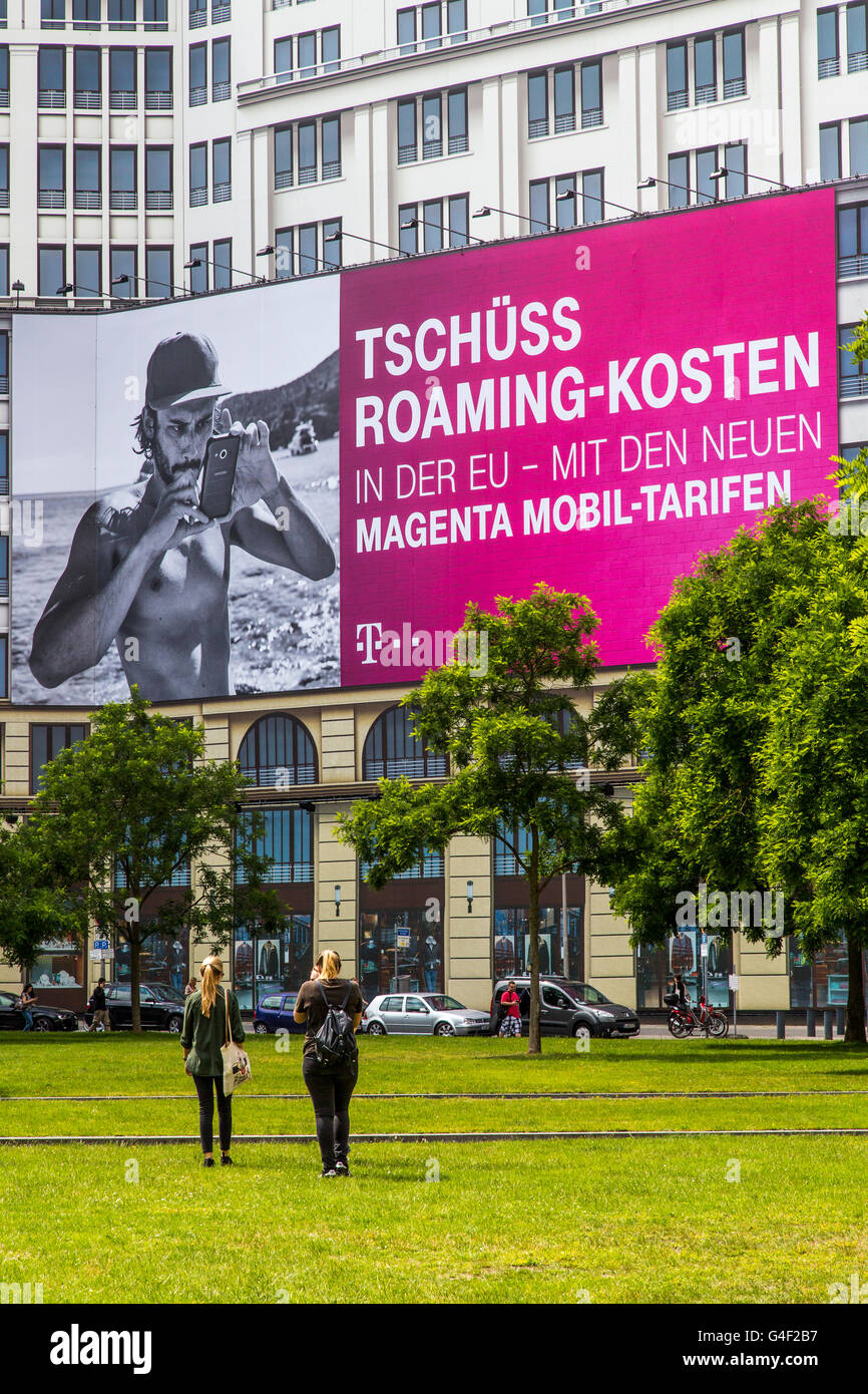 Advertising of Telekom, on a large poster at Leipziger Platz in Berlin, for a new telephone tariff,  noroaming charges - Stock Image