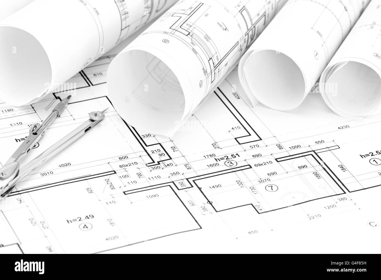 Rolls of architectural blueprints and house plan with drawing rolls of architectural blueprints and house plan with drawing compass malvernweather Images