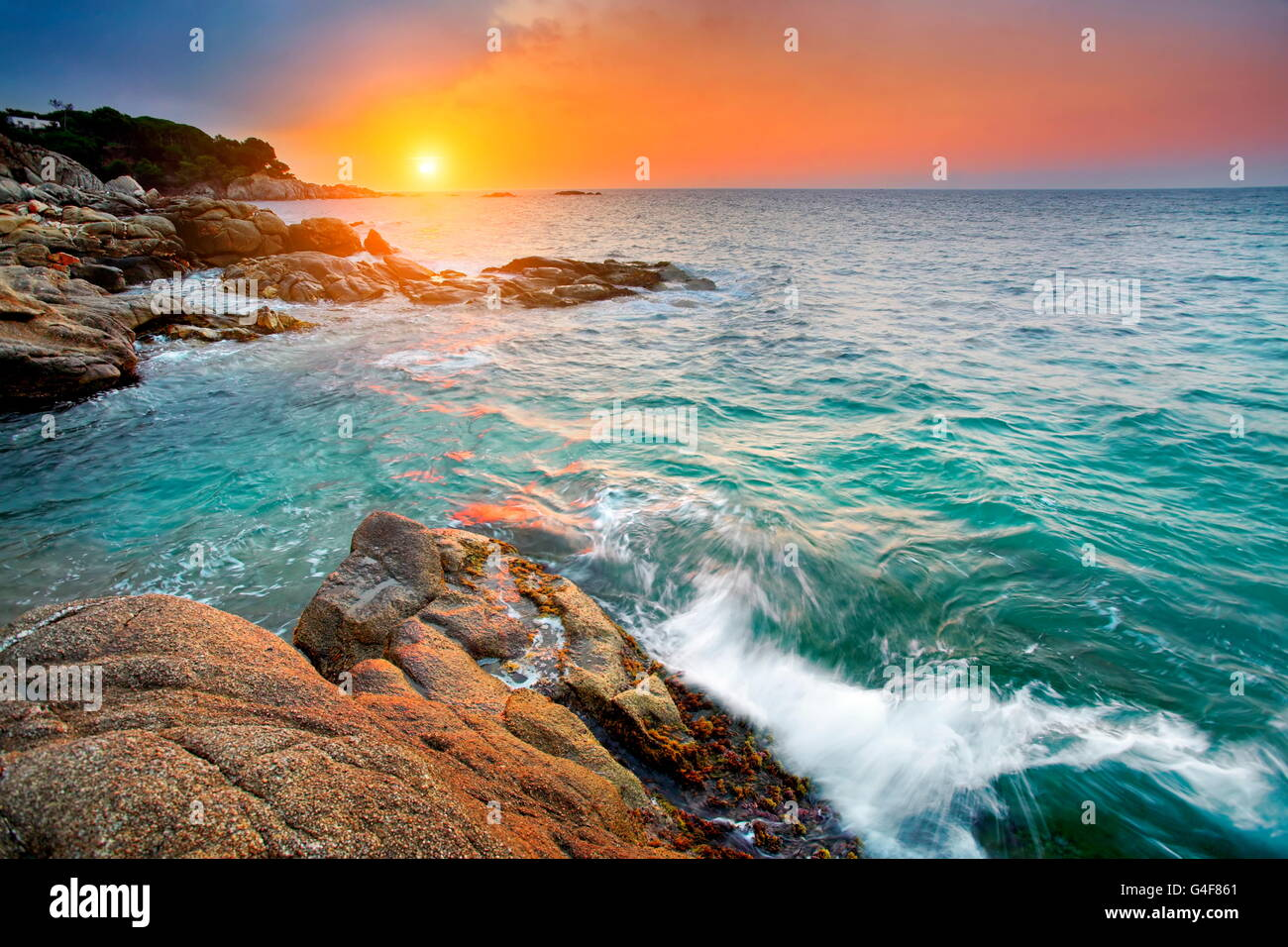 Sunrise at Costa Brava coastline, Spain - Stock Image