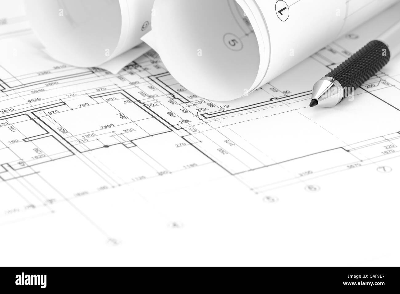 Architect workspace with floor plan blueprint roll and pencil stock architect workspace with floor plan blueprint roll and pencil malvernweather Choice Image