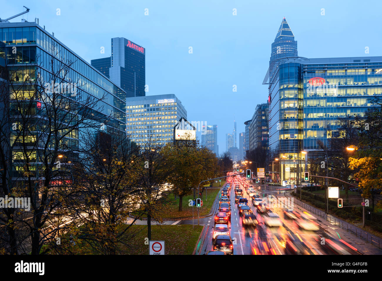 Theodor - Heuss-Allee with cars in traffic jam , night and rain with a view to the town center with the Commerzbank Stock Photo
