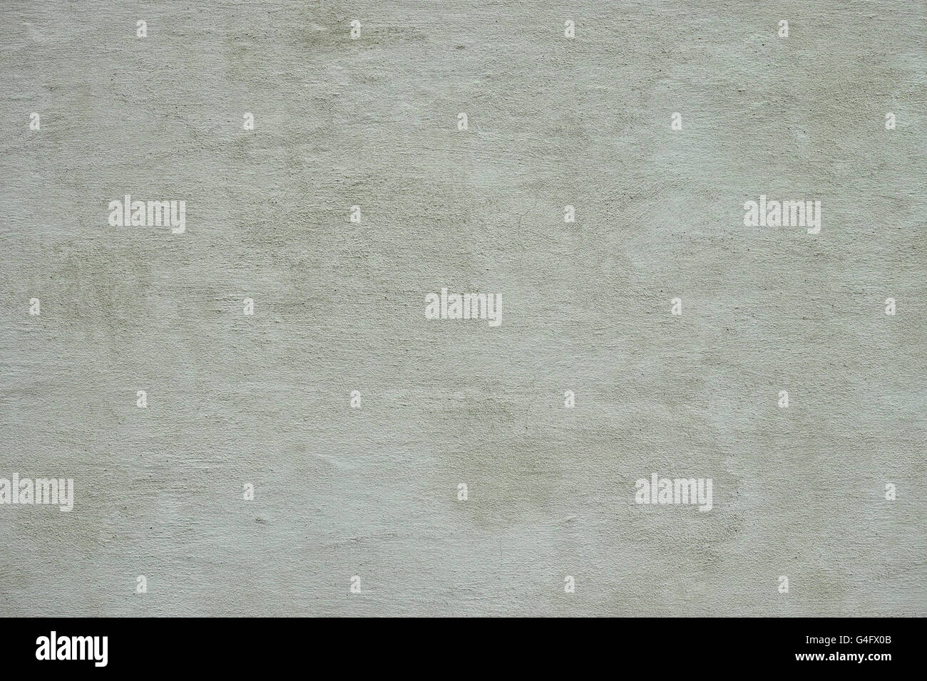 Finely textured grey coloured stucco background Stock Photo