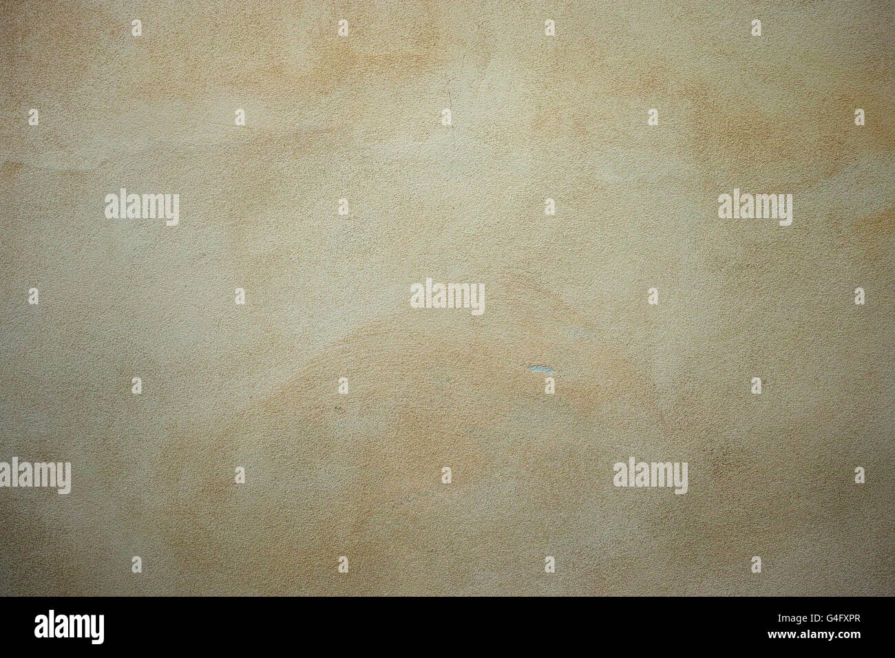 Finely textured beige coloured stucco background Stock Photo