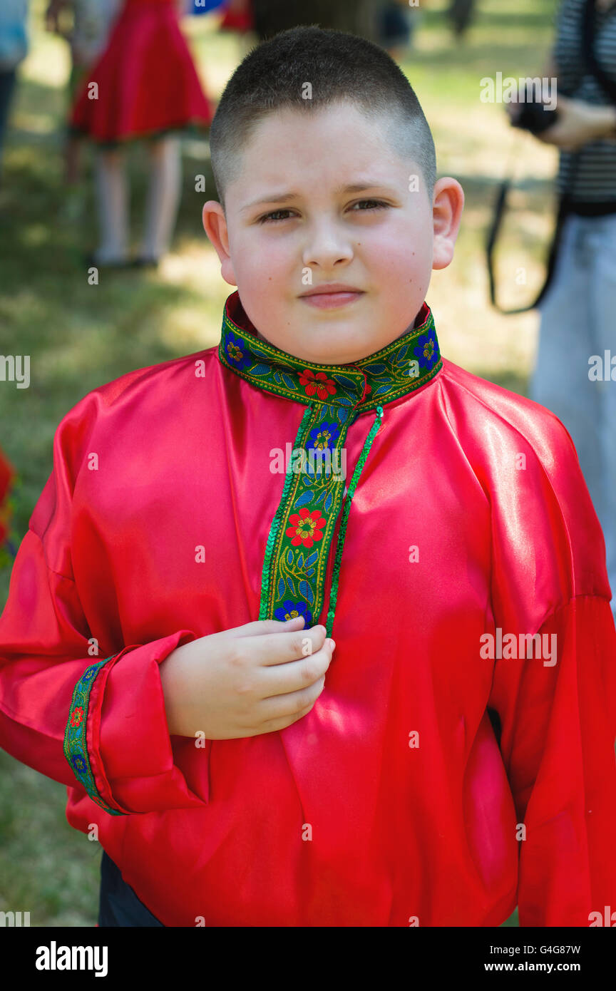 the boy's portrait in a red national Russian shirt - Stock Image
