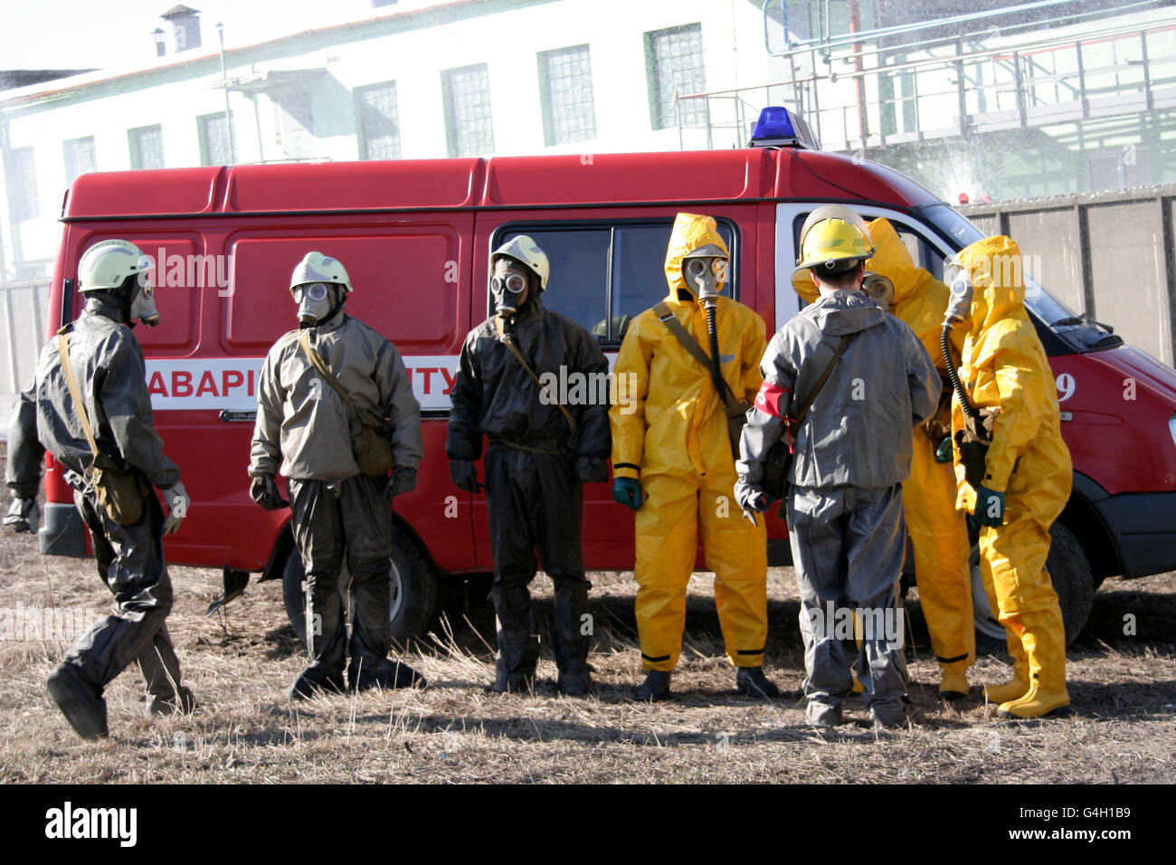 Man in chemical protection suit, carrying out the decontamination area - Stock Image