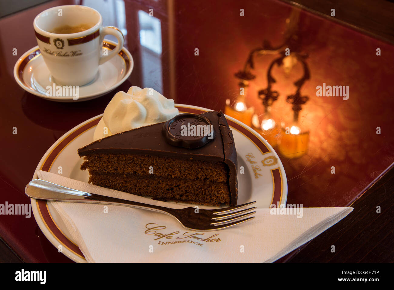 The original Sachertorte chocolate cake served at Cafe Sacher,  Innsbruck, Tyrol, Austria - Stock Image