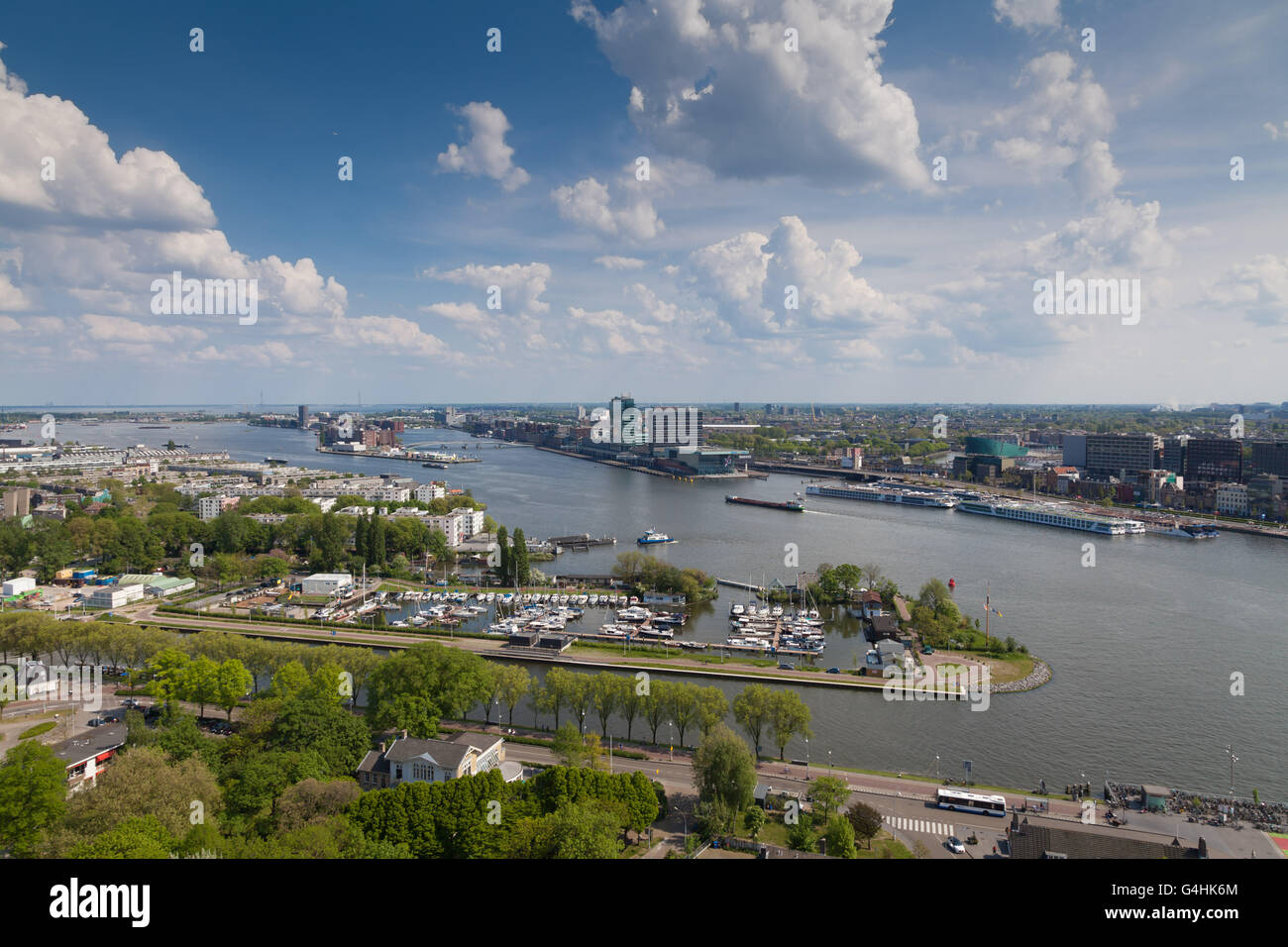 The river IJ with its marina and in the background Amsterdam and a beautiful Dutch clouds party - Stock Image