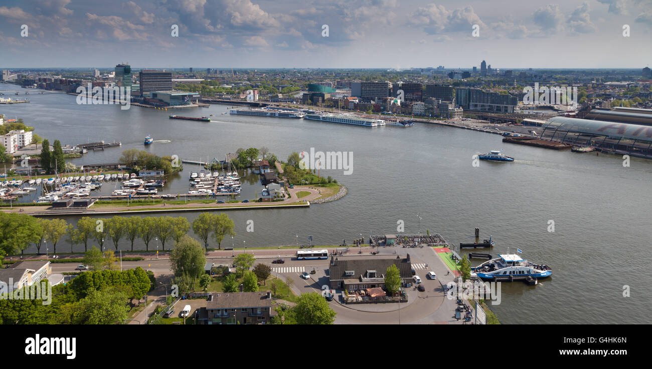 The river IJ with its marina and ferries in the background Amsterdam - Stock Image