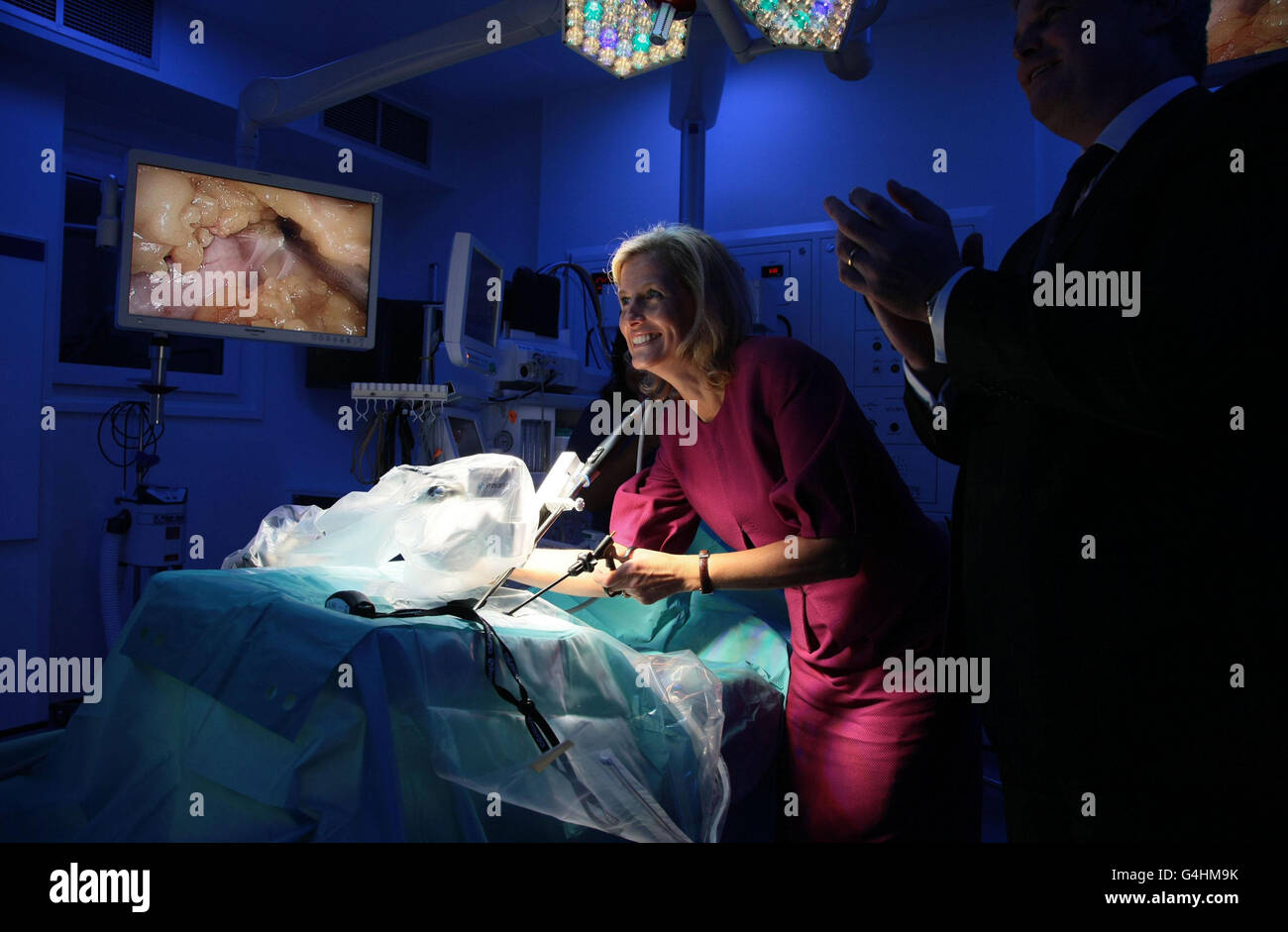The Countess of Wessex tries her hand at using the Laproscopic (keyhole surgery) trainer in the new digital theatre Stock Photo