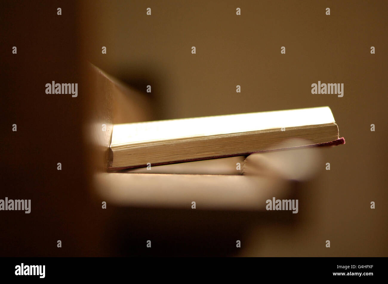 Book of Prayer resting on wooden pew Stock Photo