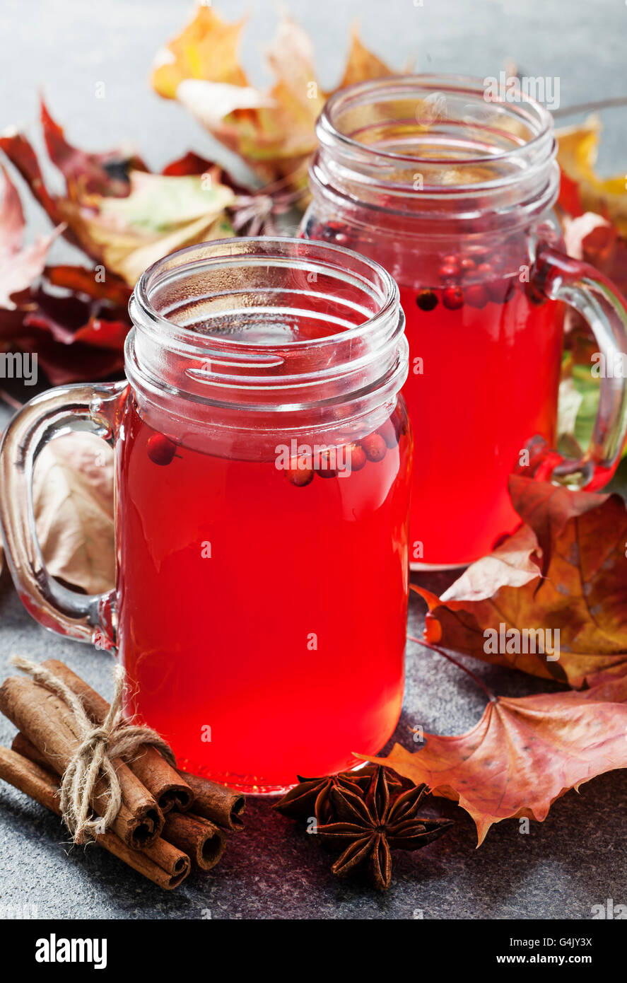Hot cowberry drink in jars - Stock Image
