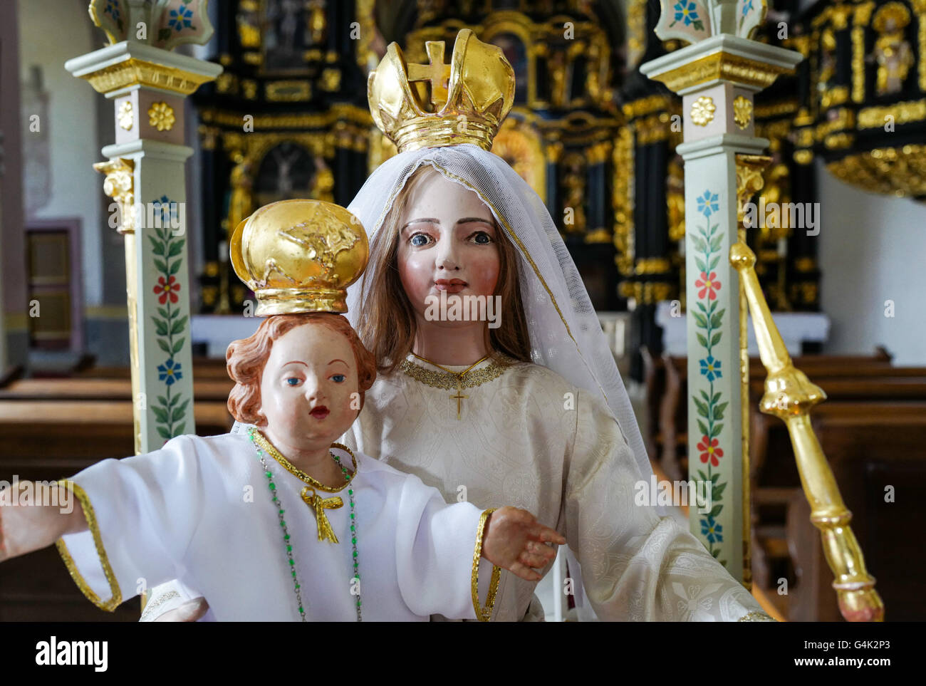 A painted statue of Virgin Mary and baby jesus in the Church at Olimje Monastery, Slovenia - Stock Image