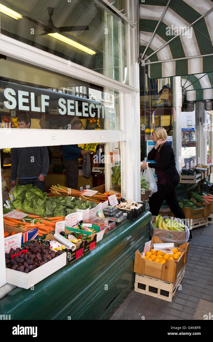 UK, Herefordshire, Leominster, High Street, Parrys greengrocers, window display open to pavement Stock Photo