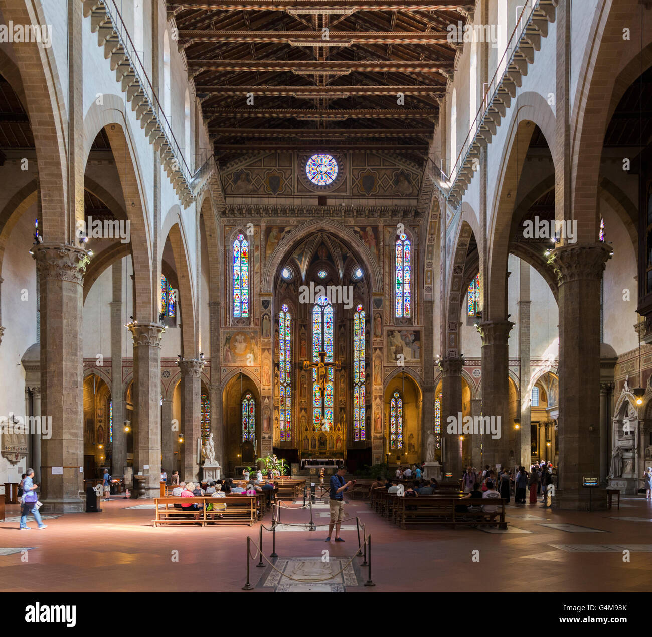 Florence, Tuscany, Italy.  Santa Croce Basilica.  View along length of nave to altar. - Stock Image