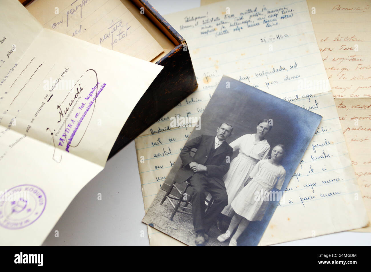 Handwritten love letters, a black-and-white family photo from 1930s and a stamped birth certificate from 1934, Estonia - Stock Image