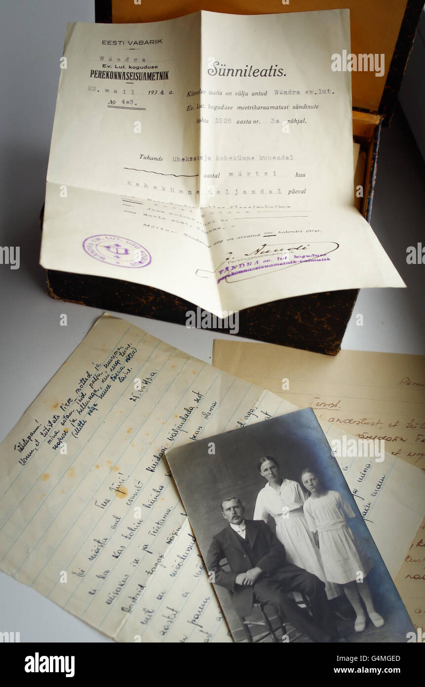 Handwritten love letters and a black-and-white family photo from 1930s and a birth certificate of Jüri Võigas - Stock Image