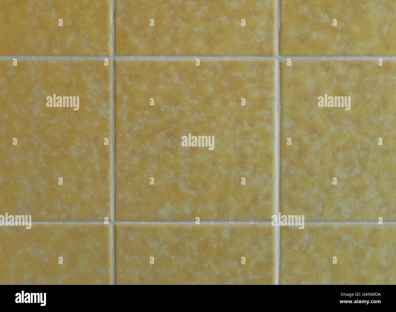 Nostalgic yellow wall tiles from the seventies - Stock Image