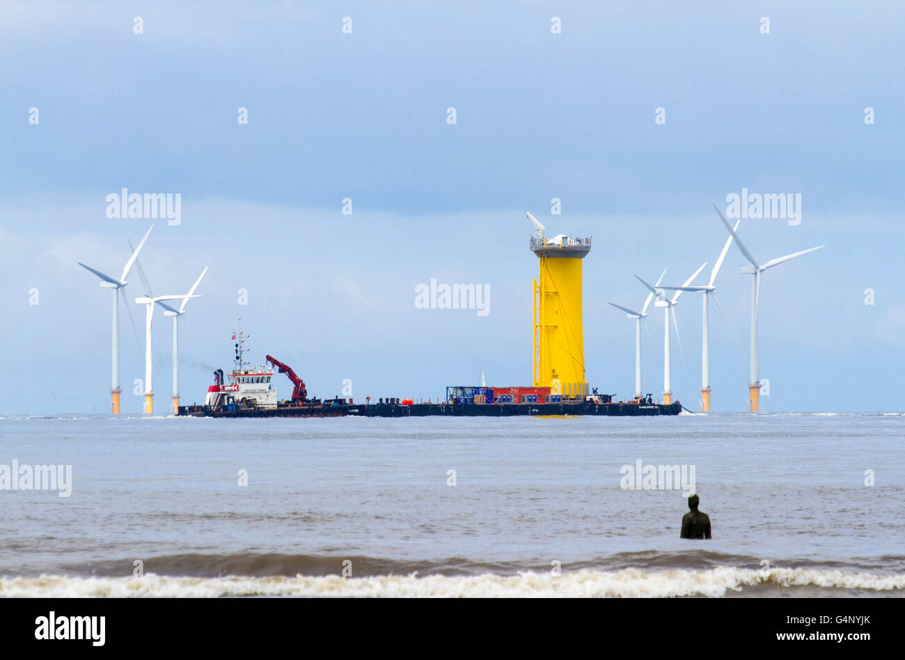 Shipping leaving the River Mersey, crossing the Burbo Windfarm, at Crosby, Merseyside, UK. Cammell Laird Wind Farm - Stock Image
