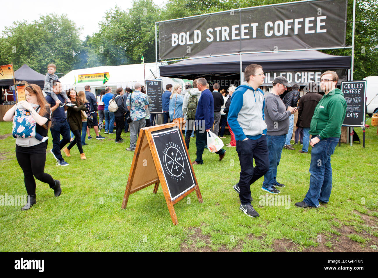 Food stall vans at the Afric Oye festival in Sefton Park, Liverpool, Merseyside, UK - Stock Image