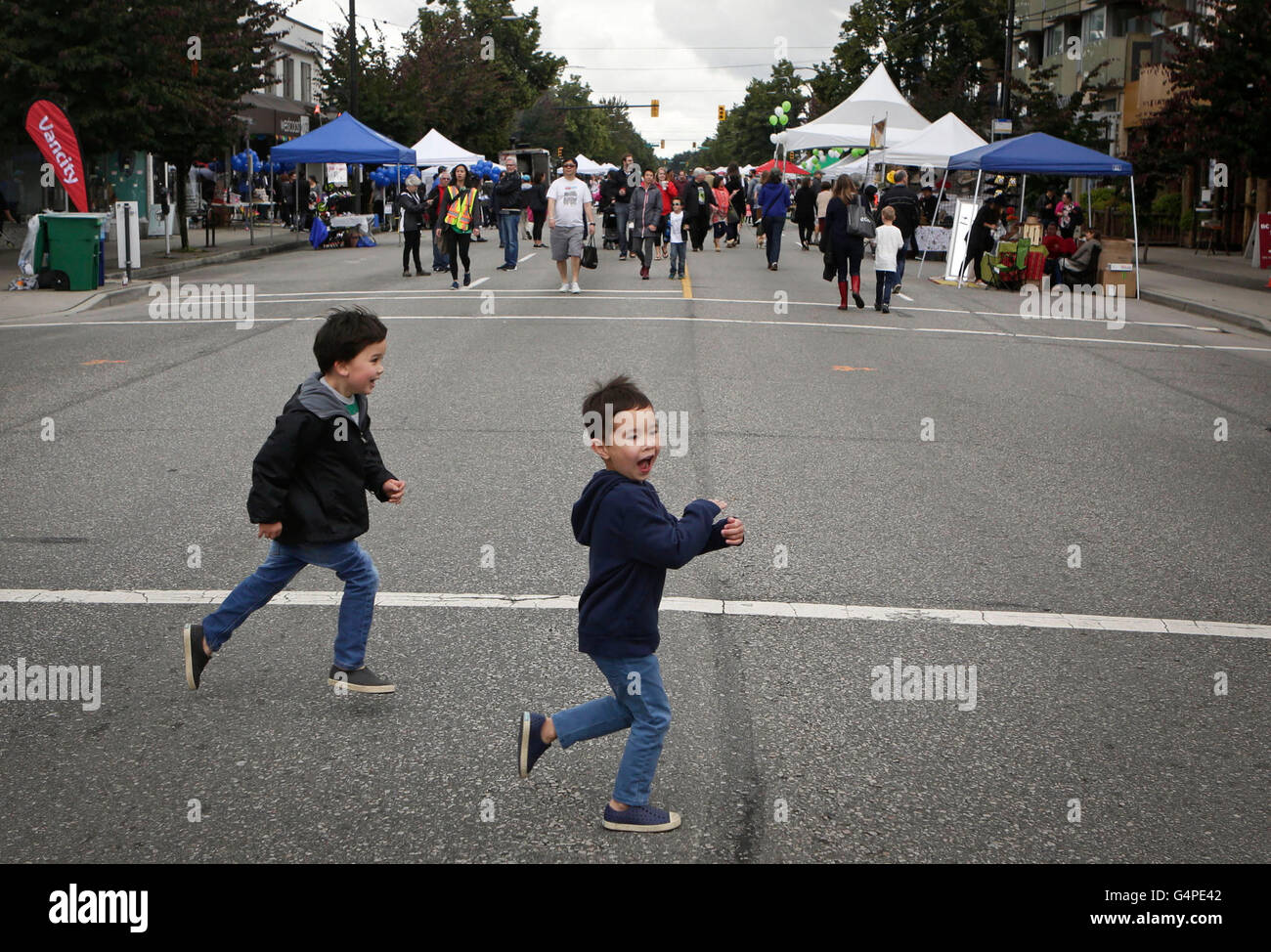 Vancouver, Canada. 20th June, 2016. Children run at a closed street during the Car Free Day event in Vancouver, - Stock Image