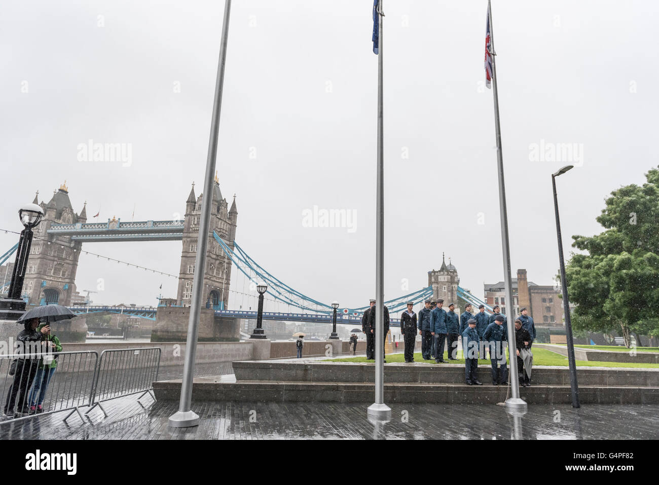 London, UK.  20 June 2016. Cadets raise a flag in the heavy rain.  The Mayor of London, Sadiq Khan, and London Assembly - Stock Image