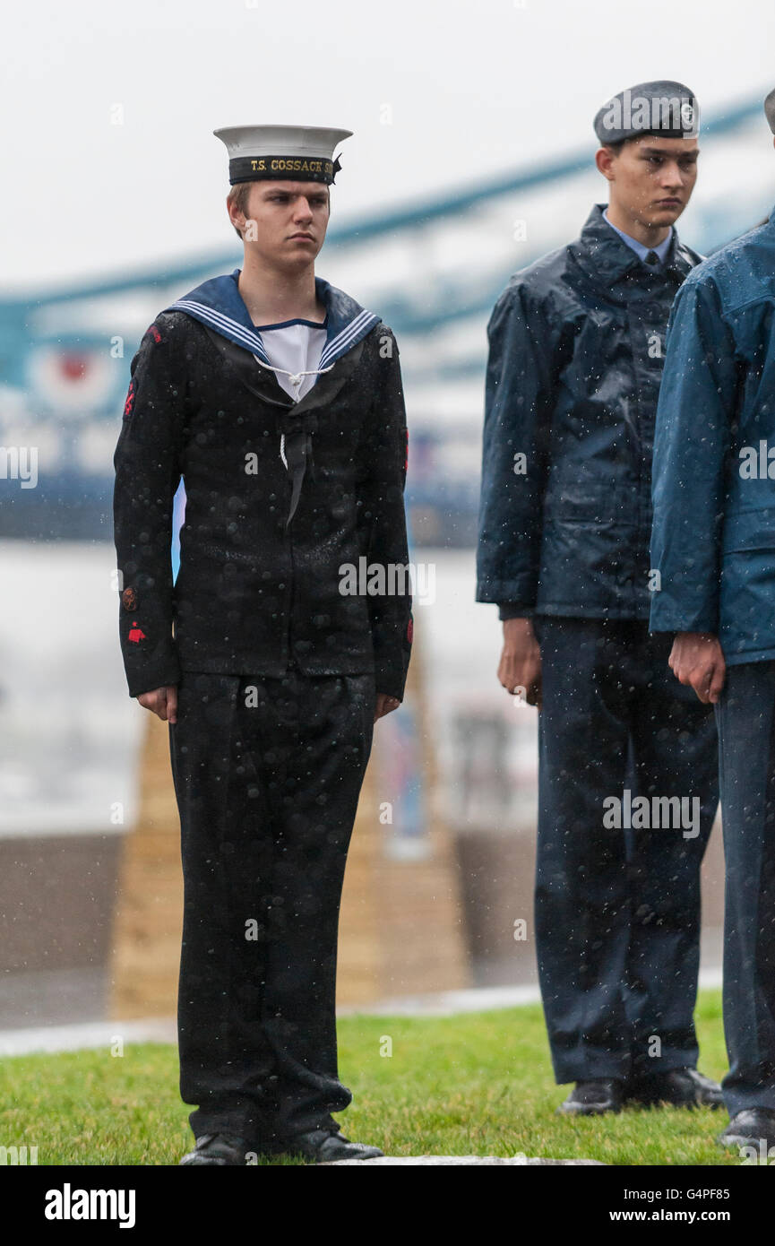 London, UK.  20 June 2016. Cadets stand at attention in the heavy rain.  The Mayor of London, Sadiq Khan, and London - Stock Image