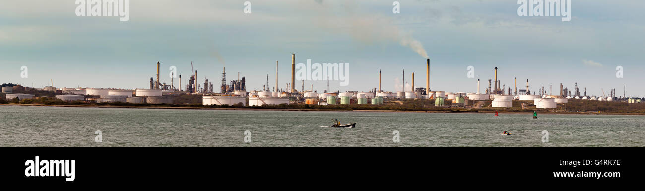 Esso Oil refinery seen accross Southampton Water from Hamble, Hampshire, England, United Kingdom, Europe - Stock Image