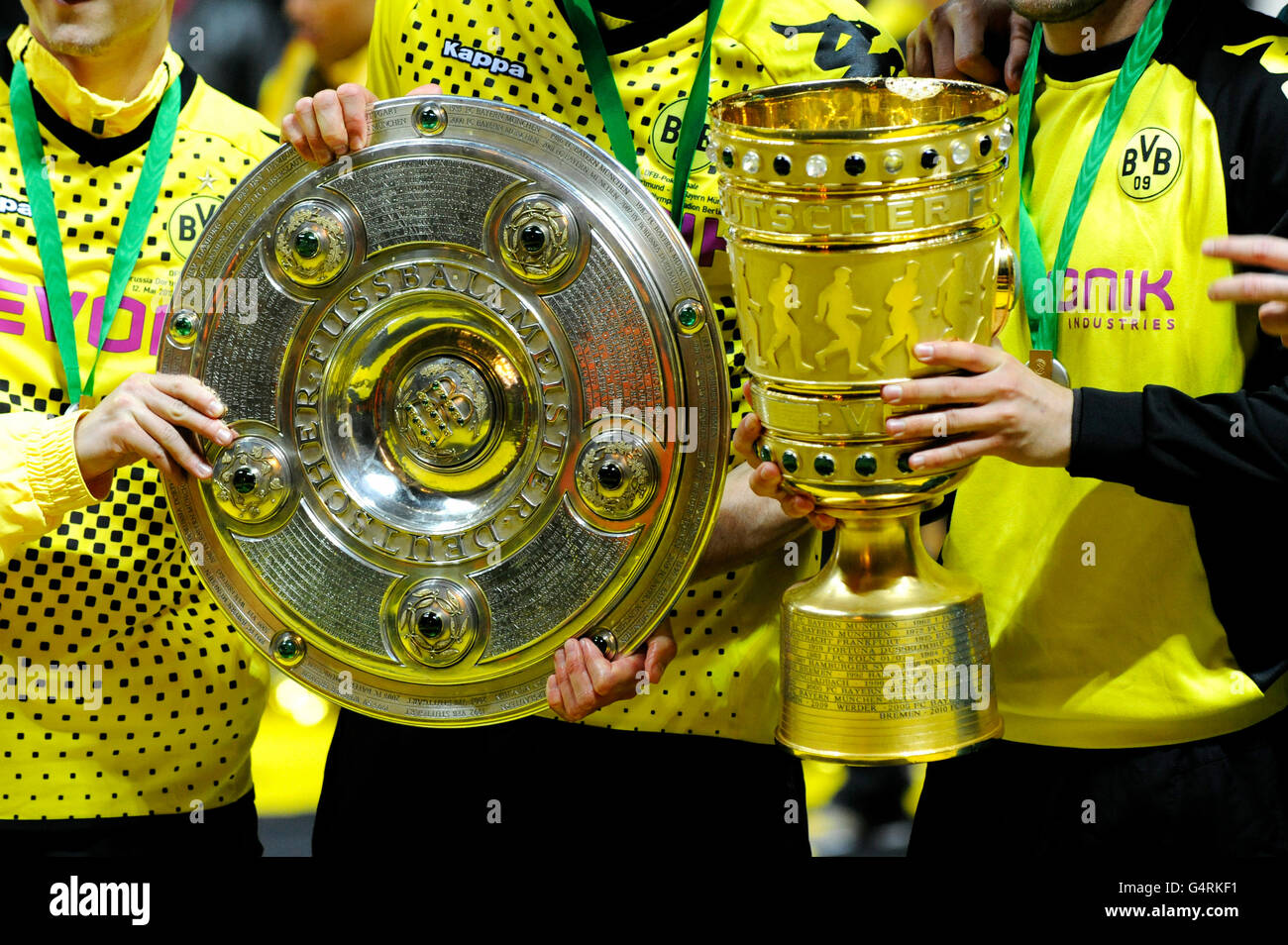 Dortmund players with the Championship Shield and the Cup, DFB Cup final, BVB or Borussia Dortmund vs FC Bayern - Stock Image