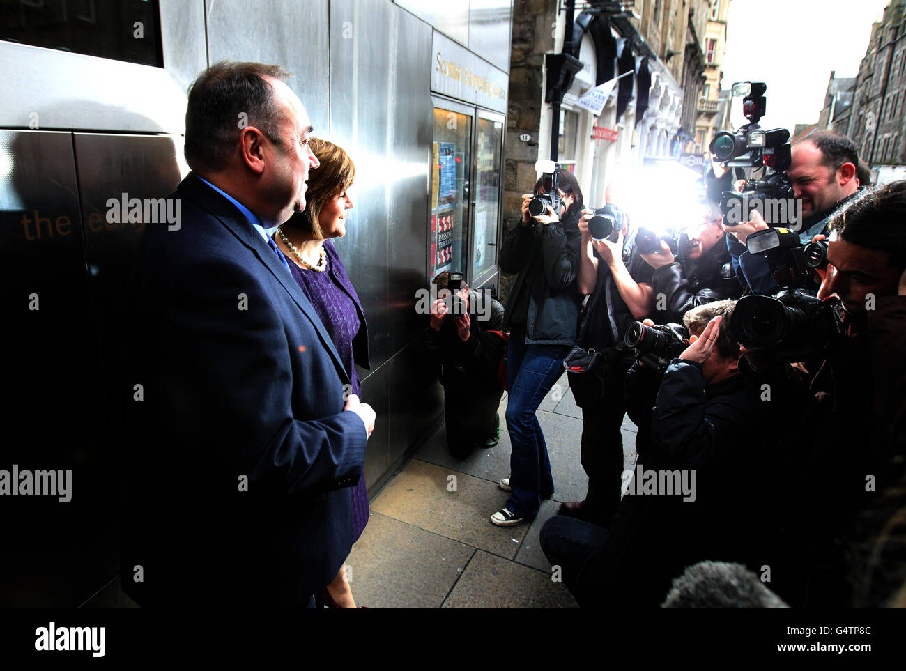 Scotland's First Minister Alex Salmond and deputy First Minister Nicola Sturgeon pose for photographers after watching Stock Photo