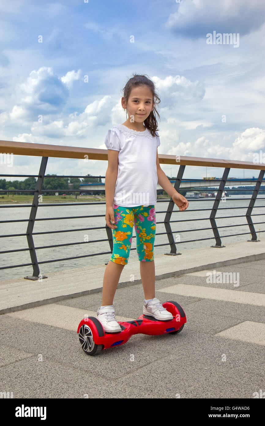 girl on the hoverboard stock photo  106277842