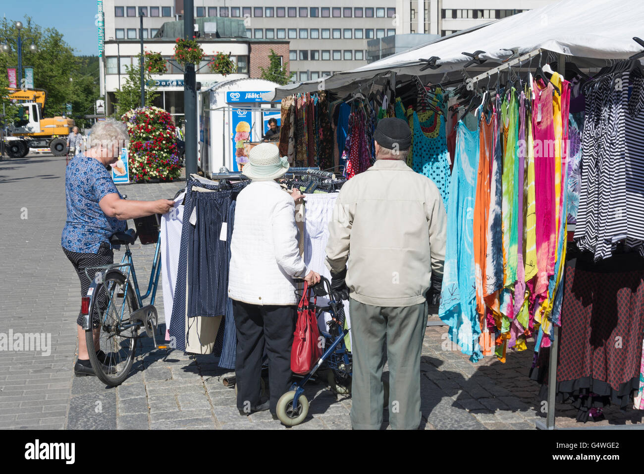 Older People buying Garments at Lahti Market Place - Stock Image